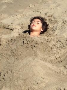 Jaden buried in sand