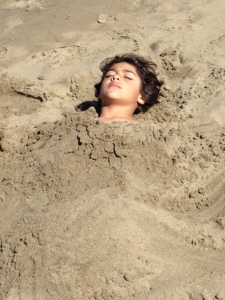 Jaden buried in sand